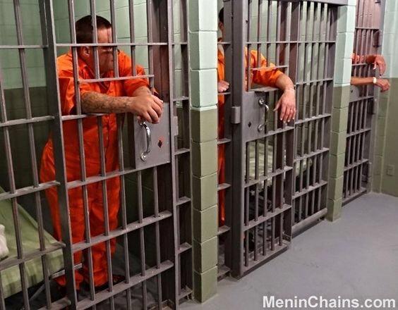 men in jail cells