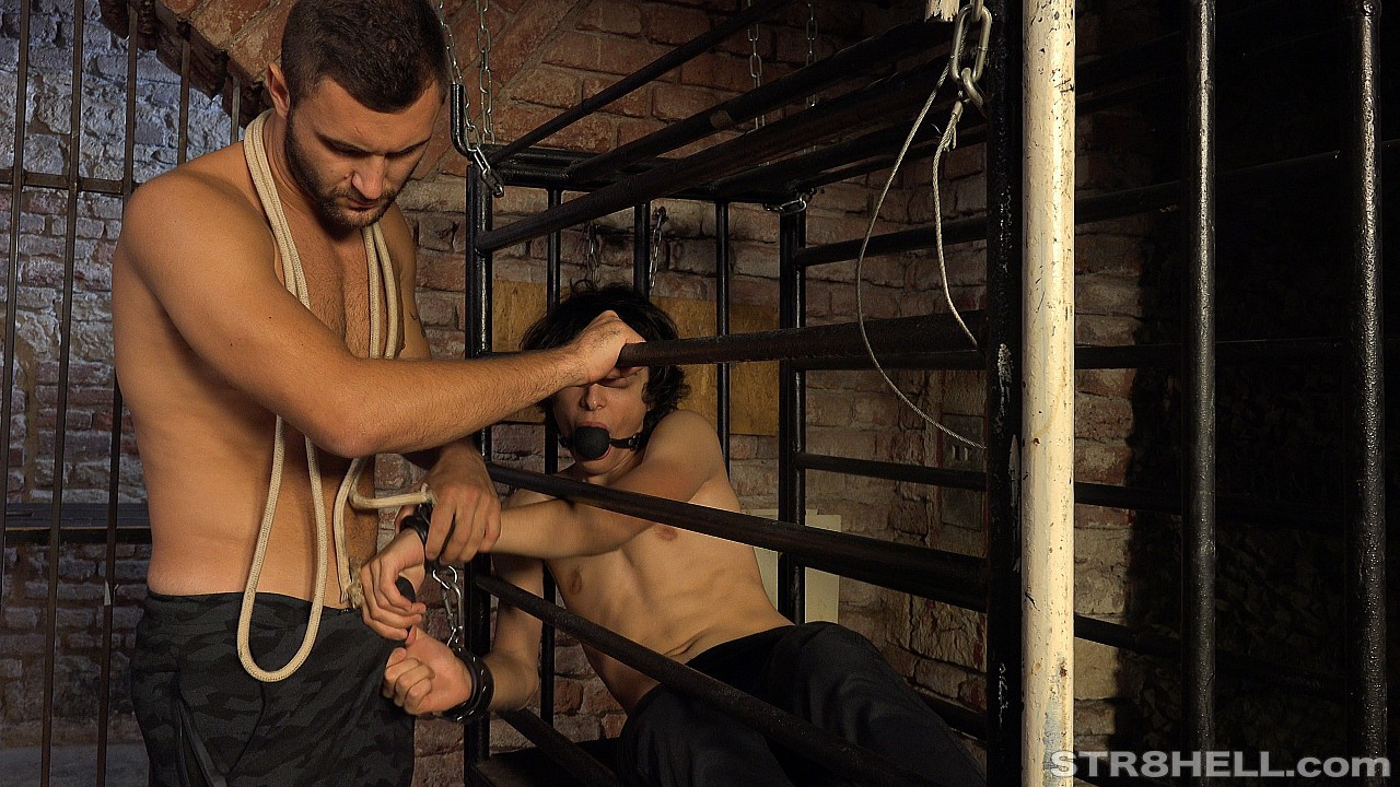 Petr is caged and shackled at Str8Hell