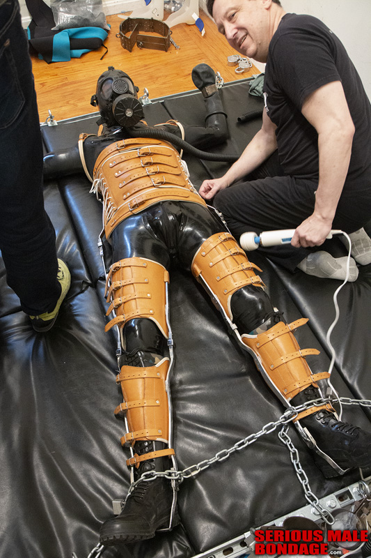 male bondage and restraint in heavy gear