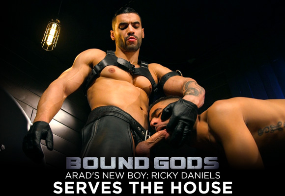 Ricky Daniels is locked in a cage, awaiting the whims of leather god Arad Winwin
