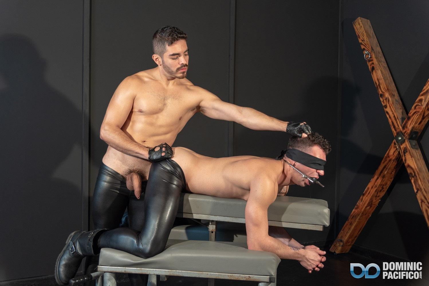 Cazden Hunter enters the black room to find Ian Greene gagged