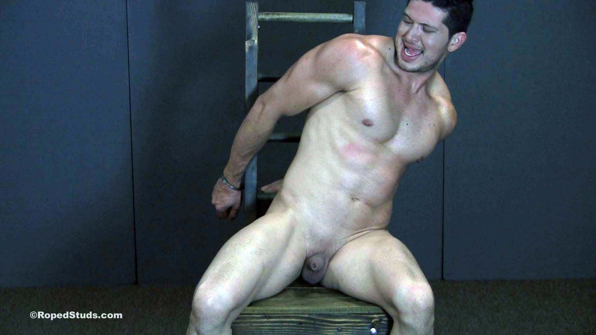 naked and handcuffed in a chair