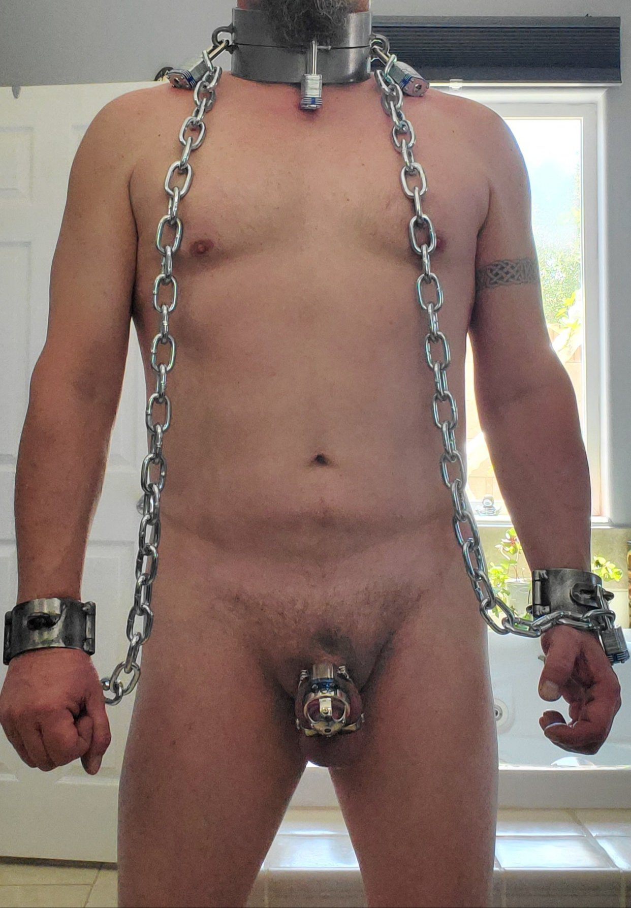 male bondage in locking metal