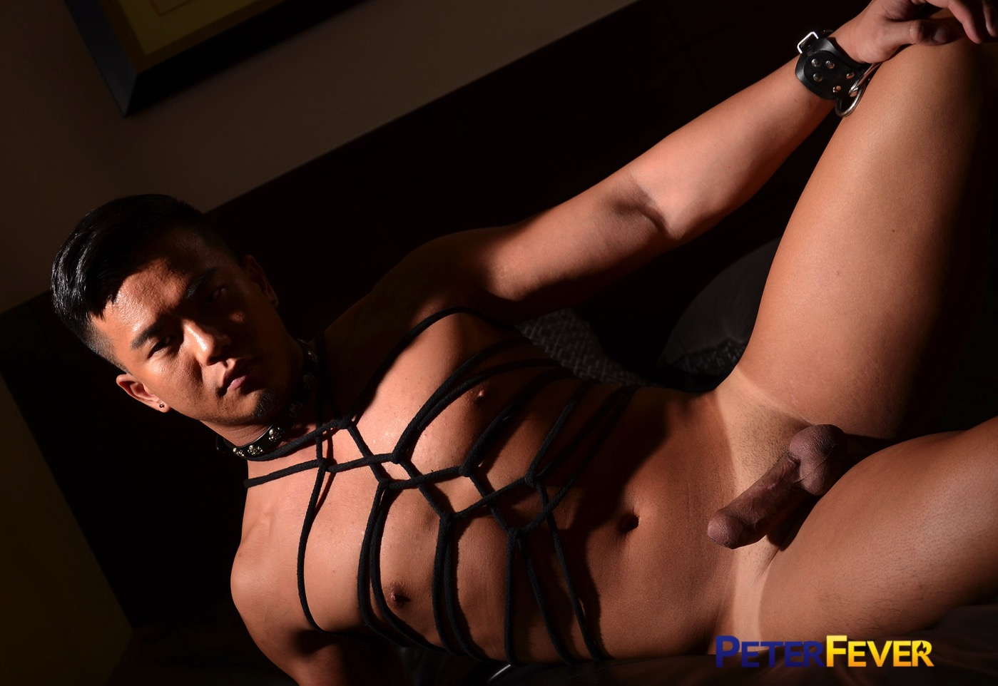 Alex is bound in leather straps from chest to throat