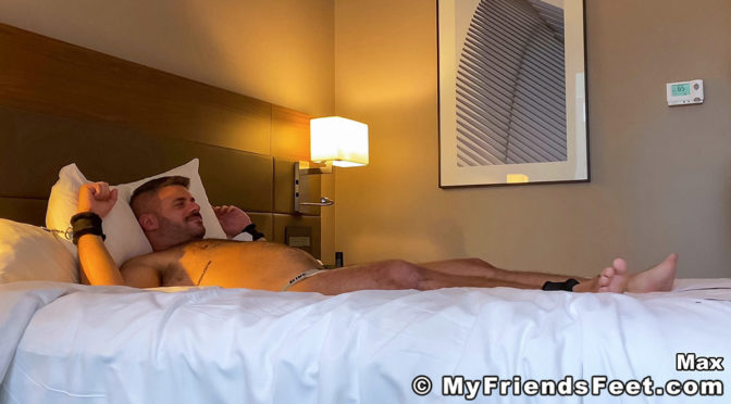 Max gets tied down and tickled in a hotel room