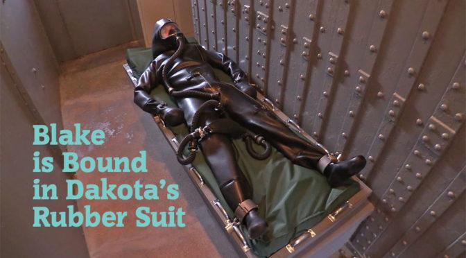 Blake is bound in Dakota's rubber suit