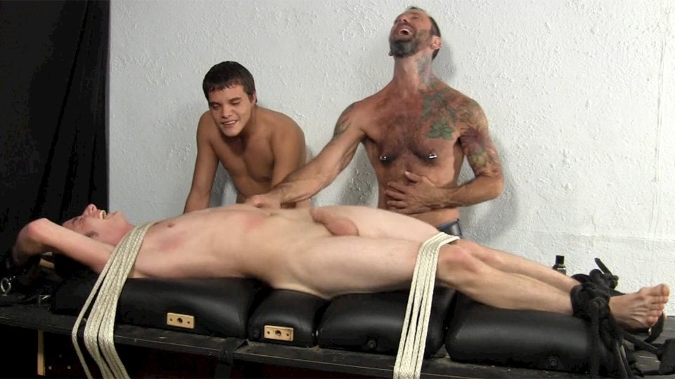 Jeff and Franco tie Thomas to the table with rope and tickle his smooth upper body