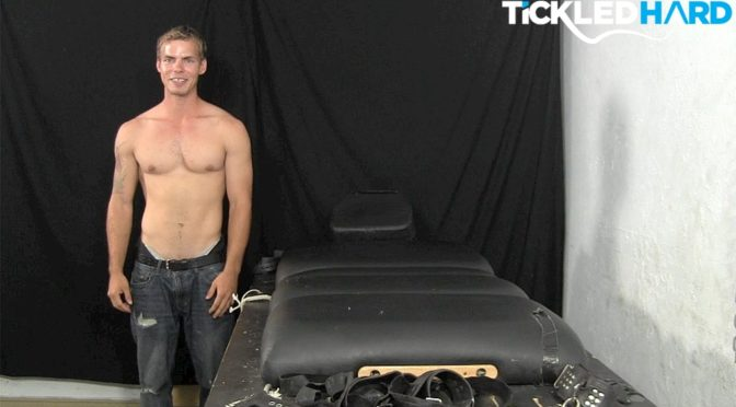 A muscular surfer gets tied up and tickle tortured