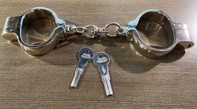 Specialty handcuffs with non-standard keys