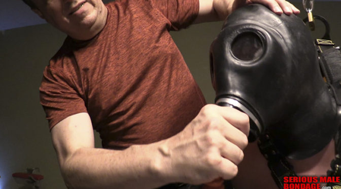 An intense bondage and jerkoff session with a gas mask and a V-chair