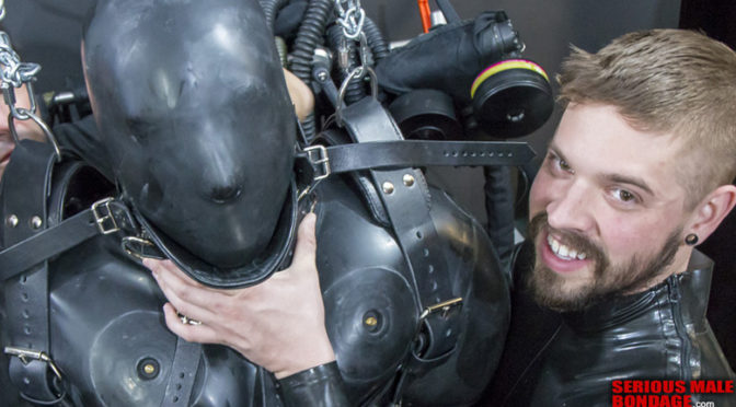 Heavy-duty male rubber bondage with posture collar and suspension