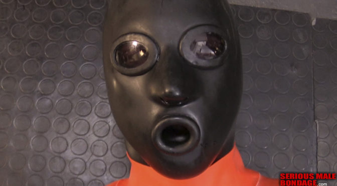 Lukas gets suspended in a rubber hood and straitjacket